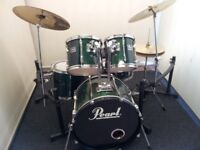 Retired drum teacher has a Pearl Export series drum kit for sale.