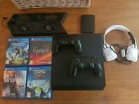 Ps4 500gb, 1tb external hard drive, 4 games, 2 controllers, charging tower and heqdset