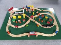 Wooden train table with police car, fire engine, buses, people and buildings