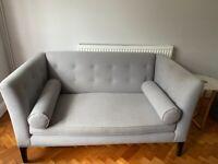 Two-seater grey sofa