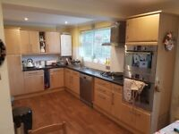 Large kitchen in Immaculate condition with Bosch Oven Grill, microwave, sink and hood for sale