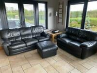 Black leather 3 and 2 seater sofas plus footstool