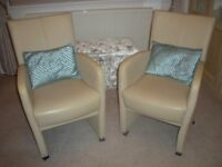 Two small cream chairs.