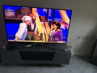 Grey gloss tv fits up to 60ich like new had couple months