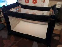 Travel cot with wheels and carry bag