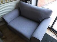 next snuggle sofa excellent condition