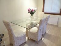 large glass dinning table and chairs