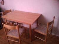 A dining table and 3 chairs for sale only £30