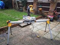 The DeWalt DW713 fixed head mitre saw and Stand as new.