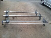 Transit van roof bars with rear roller
