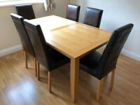 Oak finish table and chairs.