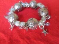 Chunky silver coloured bracelet