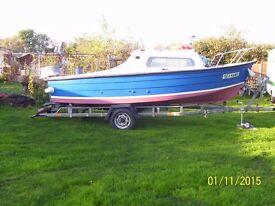16 ft fishing boat with 15 mph mariner engine rollercoster trailer.