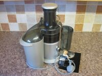 Breville Juicer in excellent condition complete with instruction/recipes book.