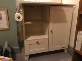 Cream baby changing table with cupboard and drawer
