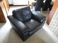 Brown leather armchair.