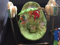 Motorised rainforest baby swing