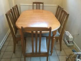 Solid wood table extends 5ft-7ft and 6 chairs