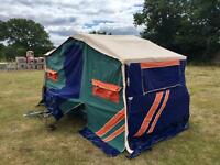 Four berth trailer tent to a separate sleeping pods that has a double bed