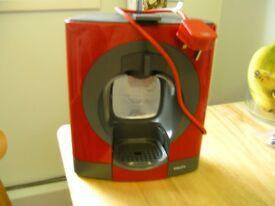 Nescafe Dolce Gusto coffe machine in red.