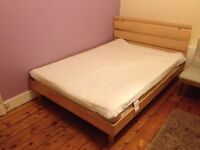 Wooden construction double bed