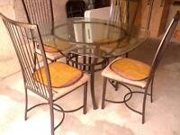 Glass top 4 seated dining table