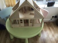 Dolls wooden house with furniture
