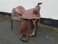 Western Saddle for sale, 16in from pommel to cantle, attractive tooling and stitching