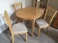 extending dining table and 4 chairs set