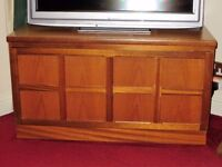 Nathan teak TV stand with cupboard storage. Good condition.