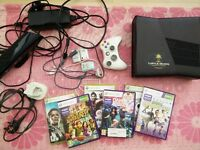 Xbox 360 Slim 4GB version + 320GB internal HDD, 1 official wireless pad, Kinect and 6 games.