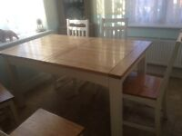Extending dining table and 6 chairs for sale. Solid oak with cream finish