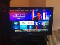 "Toshiba LED Regza 37"" TV with black glass stand"