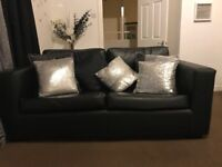black leather sofa in mint condition for sale