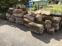 Reclaimed sandstone wall