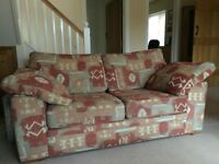 """Three seat and two seat matching sofas in Terracotta """"Aztec"""" design"""