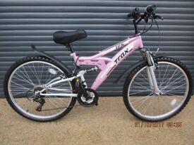 TRAX LADIES / TEENAGERS SUSPENSION BIKE THAT HAS ONLY BEEN USED ONCE. (MAKE IDEAL PRESENT).
