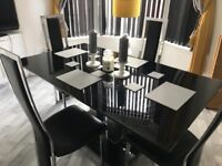 SOLD!! Black glass dining table and 4 leather chairs