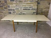 Extendable part painted wooden dining table