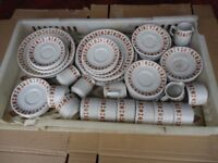 Tray full of brown and white crockery over sixty pieces