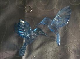 Two blue plastic humming birds ex con