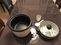 Kenwood rice cooker with vegetable steamer and rice fan.