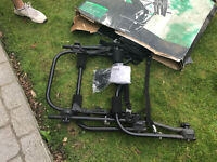 car bike rack. sits on rear of car. holds up to three bikes . brand new