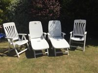 Two chairs and two sun loungers