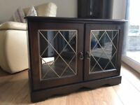 Priory oak TV/ highfi cabinet in excellent condition. on casters.