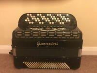 Guerrini 5 row button key continental C system, accordion in lovely condition.