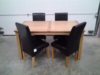 Ex display extendable table and 4 black faux chairs. 1/3 shop price, can deliver.