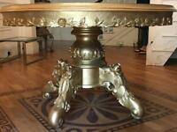Big gold round solid wood table
