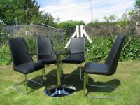 Black glass table and 4 matching chairs