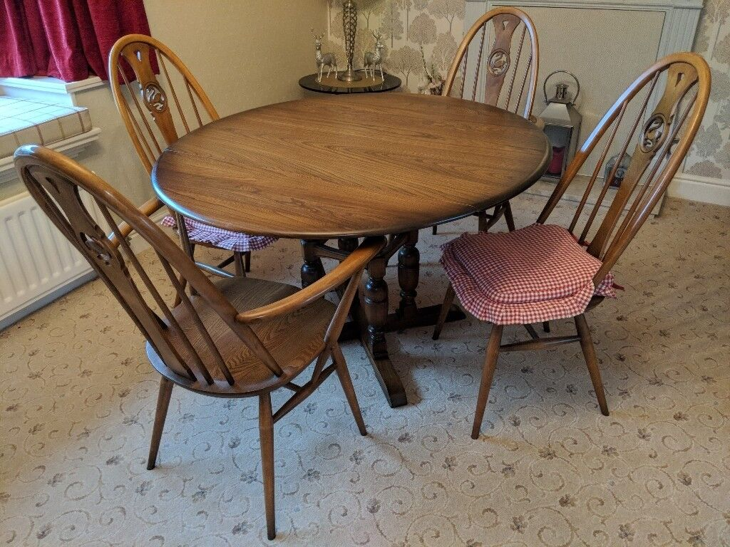 Ercol dining room table, chairs and matching items